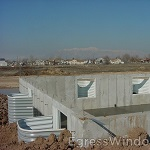 IRC 2009 requires egress windows in every habitable space. Egress wells installed on a new foundation.