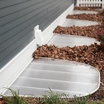 Window well covers with optional grates added to the Easy Egress kits in White.