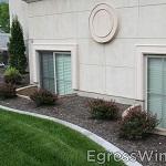 Rockwell window wells beautifully set off two large egress windows, IRC 2009 code compliant.