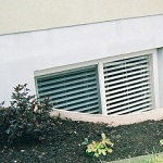 Finished basements require a safe means of egress by law. Two egress windows with wells installed.
