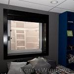 Basement bedroom with Wellcraft 2060 egress well installed in case of fire or other emergency.